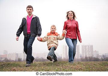 family walk outdoor. city.