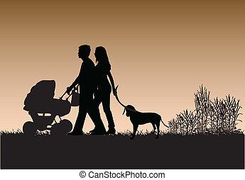 Family walk the dog
