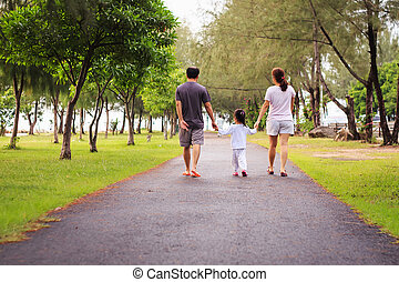Family walking at park in the morning