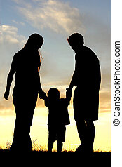 Family Walking at Sunset Silhouette