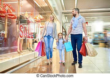Family Walking by SALE Shop