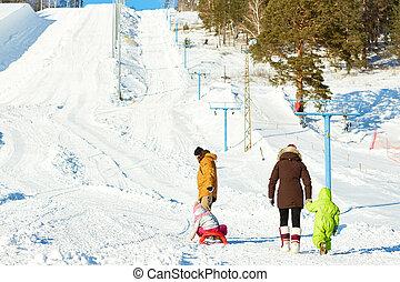 Family walking in ski resort