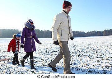 Family walking in winter. Family take a walk on winter