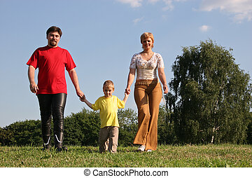 family walking on meadow
