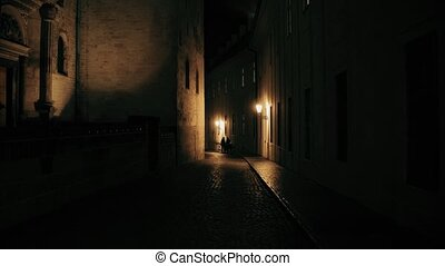 Family walking on old town street in Prague at night. 4K steadicam shot