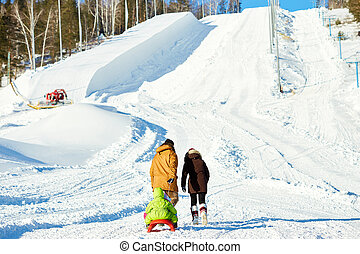 Family walking on snow hill