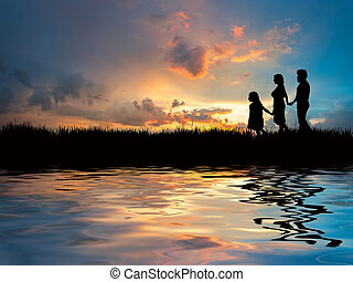 Family walking on the beach - Happy family walking on the...