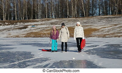 Family walking on the frozen lake - Mother and daughters...