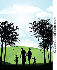 Silhouette of a family walking outside in the countryside