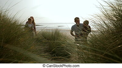 Family Walking Through Sand Dunes - Low angle view, looking...