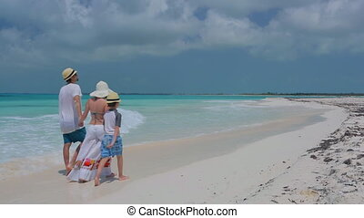 Family walking together at beach