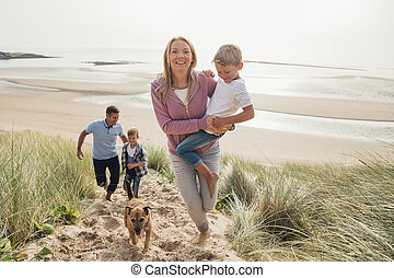 Family Walking Up a Sand Dune