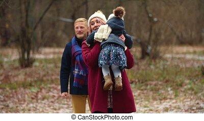 family walks in the winter park