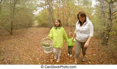 family walks through the autumn forest
