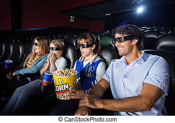 Family Watching 3D Movie In Cinema Theater