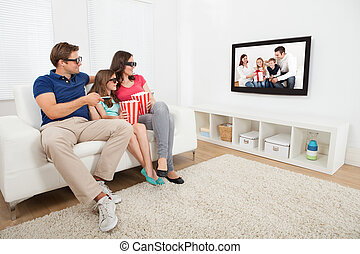 Family Watching 3D Movie On Television