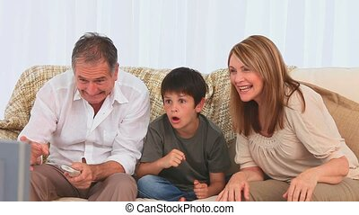 Family watching a match on tv