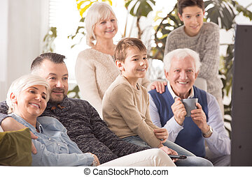 Family watching a movie - Happy family watching and enjoying...