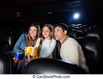 Family Watching Movie In Cinema Theater