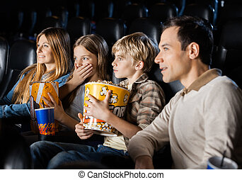 Family Watching Movie In Theater
