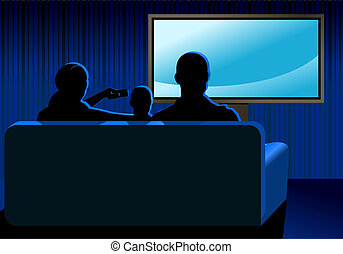 Family watching TV in the dark room