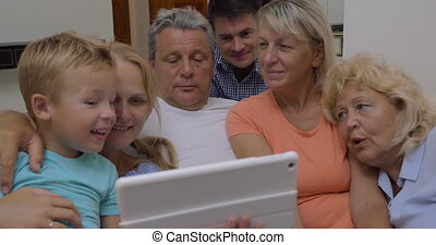 Family watching video on tablet computer