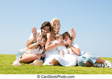 Family waving hands at camera