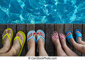 Family wearing brightly colored flip-flops