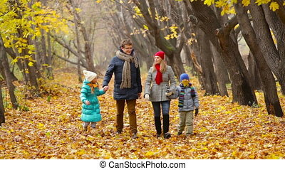 Family Weekend - Family taking a walk in the autumn park...