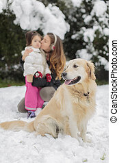 Family with a dog at winter