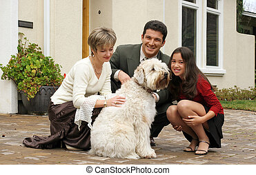 Family with a dog - Happy family with a dog in front of the...