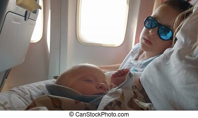 Family with baby and elder son traveling by air