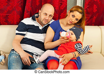 Family with baby girl home
