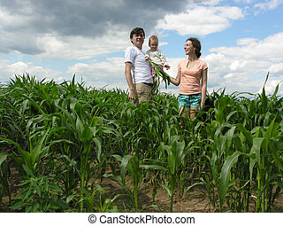 family with baby in field