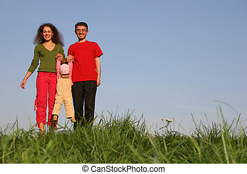 family with baby on grass