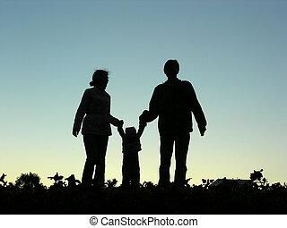 family with baby sundown