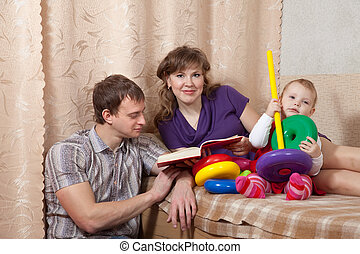 Family with book at home