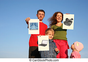 family with boy and baby with wishes cards on sky collage