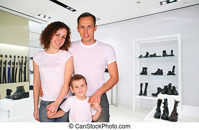 family with boy in Division of store with foot-wear and belts