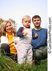 family with boy in grass
