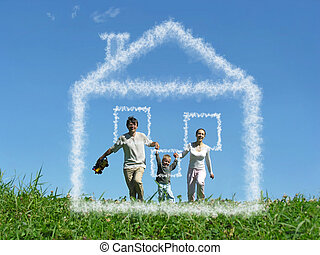 family with boy on meadow and dream cloud house collage