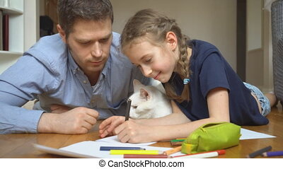 Family with cat drawing on the floor.