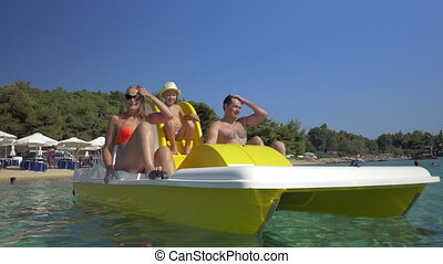 Family with child enjoying pedal boat ride