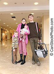 family with children in shop