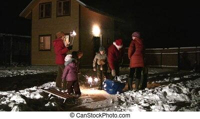 Family with children lighting bengali lights
