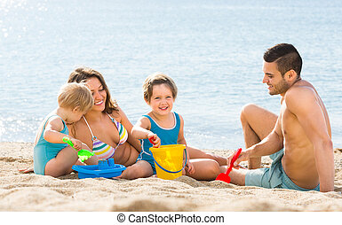 family with children on beach