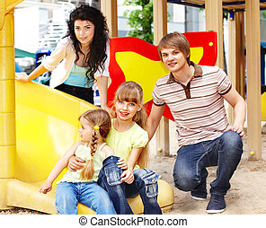 Family with children on slide outdoor.