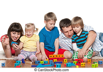 Family with children on the floor