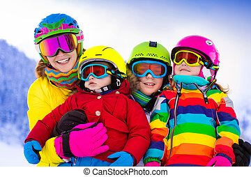 Family with children on winter ski vacation - Mother and...