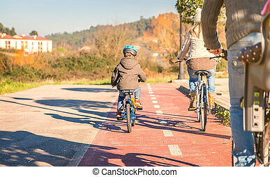 Family with children riding bicycles in the nature